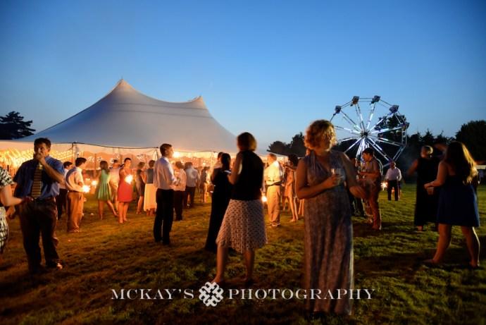 Rustic Farm Wedding Photos with ferris wheel at wedding near Rochester NY by McCarthy Tents