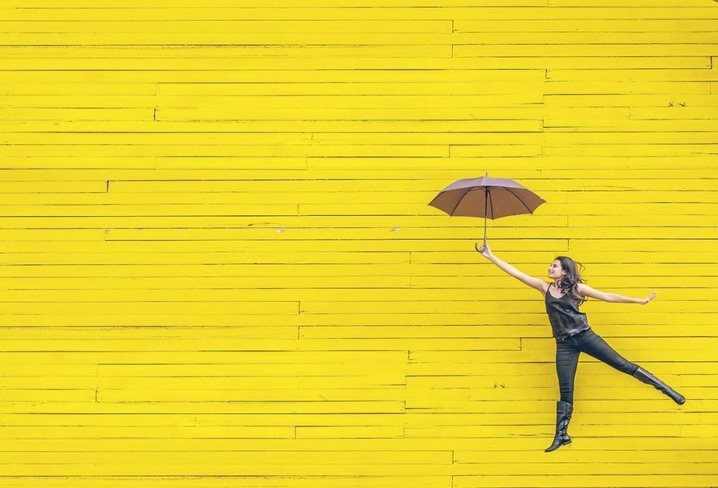 lady with a yellow background and umbrella