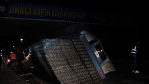 Driver Escapes Unharmed as Trailer Overturns on Highway Entrance