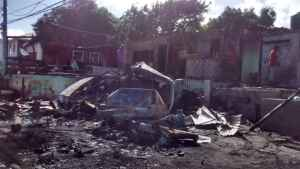 Trailer Explodes Blowing-up Shop along Lilliput Main Road