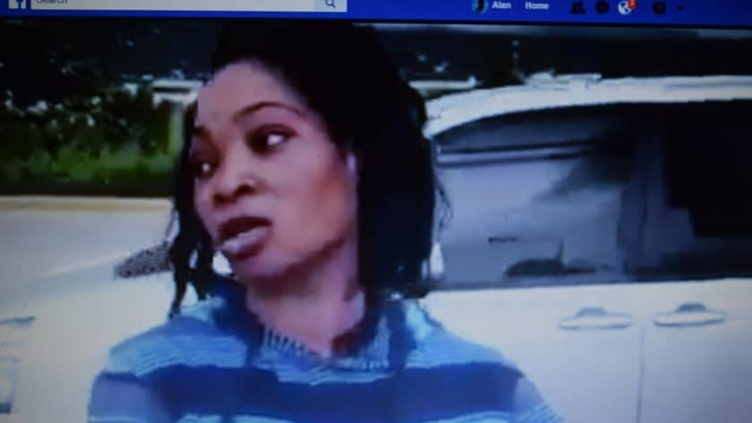 Mobay Woman Demonstrates at Freeport Police Station