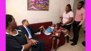 PM Holness Moved By Story of Tahj Rowe and Makes Personal Donation