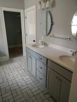 We repainted the exiting vanity and added a quartz top