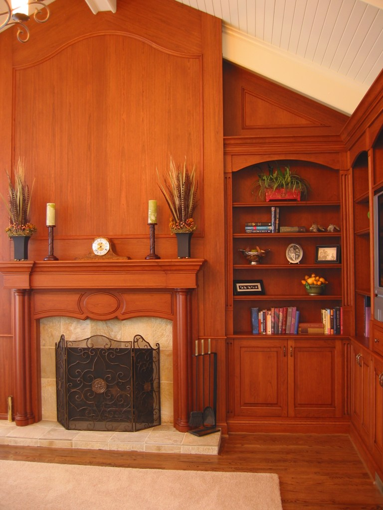mantel paneling and custom book cases