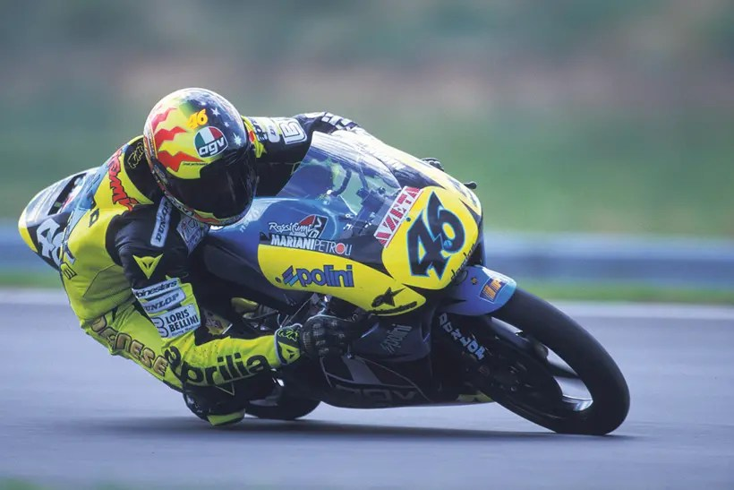 Rossi riding a 125