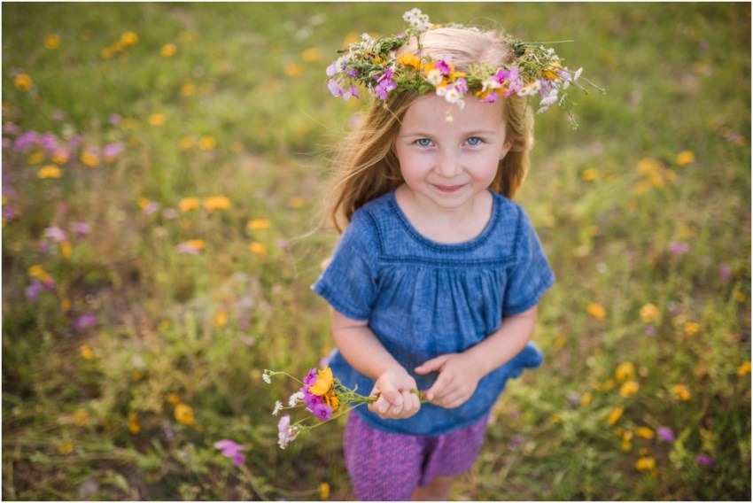 beautiful little girl with flowers | Jacksonville Children Photographer