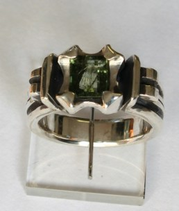 Ring: silver, tourmilated peridot