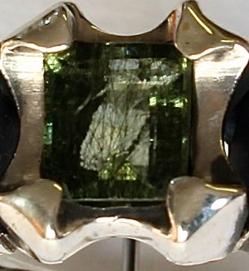 Ring: silver, tourmilated peridot (detail showing the stone)