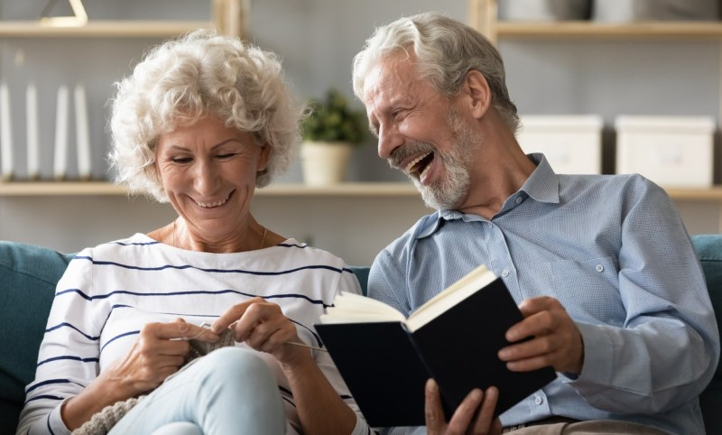 Happy mature couple engaged in favorite hobbies on home weekend