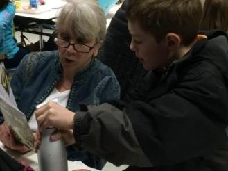 Cindy Herndon Reading with Student