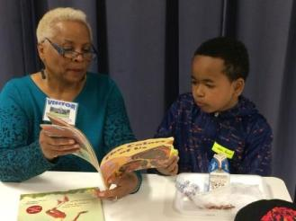 Ada Summers Reading With Student