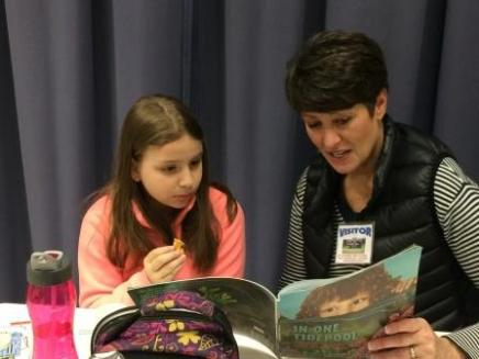 Jeannine Leffel Reading With Student