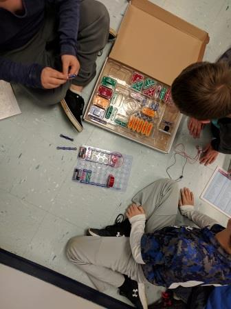 Students Working With Electricity Kits