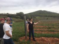 Maya Hood White Explaining Viniculture