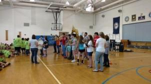 Alicia Strickler Leading Band Students