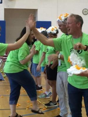 Teachers Becky Weigle, Scott Aylor, and Chris Donner Celebrating With Students