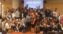 Michel, illustrator Claudia Dávila and YTV host Carlos Bustamante with students at the Toronto Public Library launch of CHILD SOLDIER