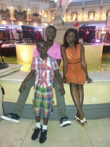 Kofi with his little brother and sister in Ghana. Photo courtesy of Kofi Owusu Acheampong.