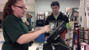 Freshman Alex Sciacchitano uses a meal swipe in the Leo Cafe.
