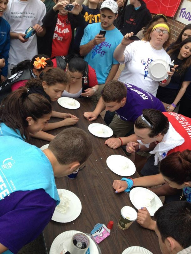 Students participate in a pie-eating contest to raise money for cancer research. Photo by Stephanie Bramante.