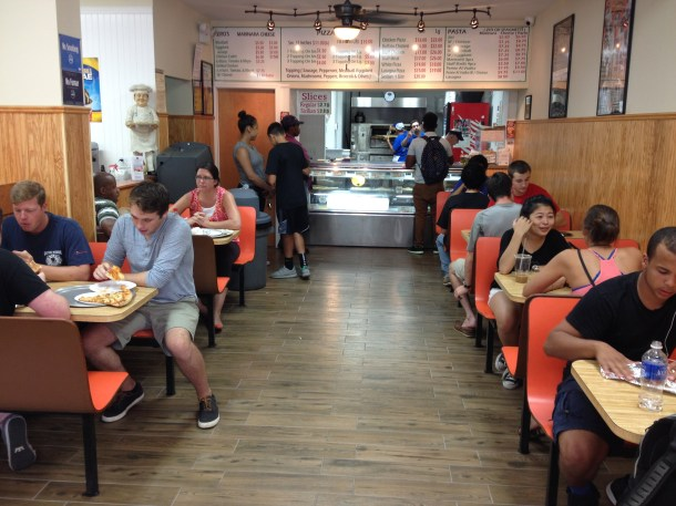 Students and local residents chow down at Broadway Joe's Pizza new location at 5985 Broadway. Photo by Sean McIntyre.