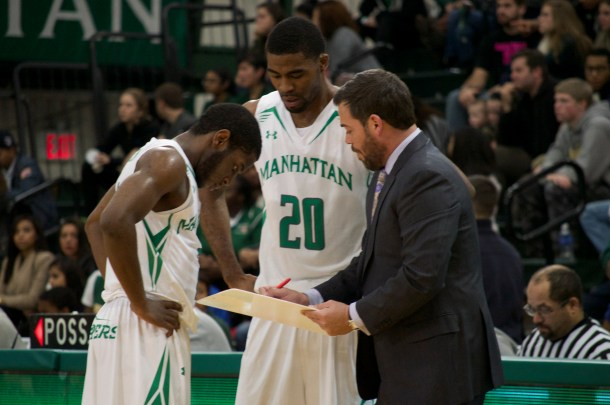 Steve Masiello, right, instructs Jermaine Lawrence, middle, and Tyler Wilson, left. Photo taken by Kevin Fuhrmann.