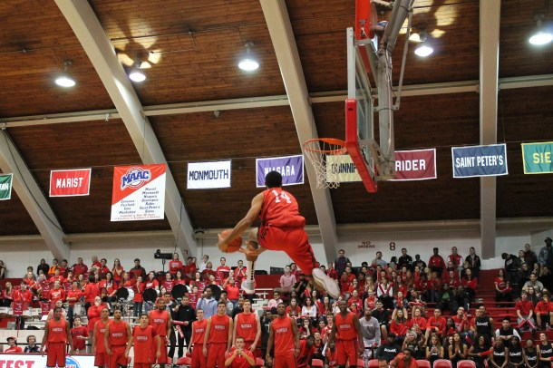 unior Marcus Gilbert skies for the between-the-legs slam dunk during Red Sea Madness, Fairfield's annual men's and women's basketball preview show. Photo courtesy of Patrick Kiernan/The Mirror.