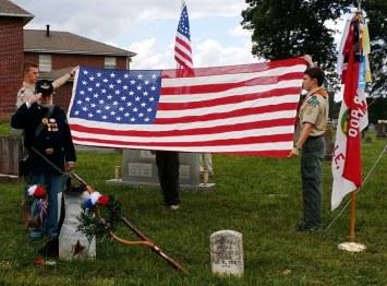 Scouts prepare flag for presentation