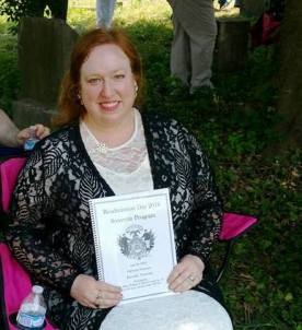 Amy Fitzsimons holding Souvenir Program
