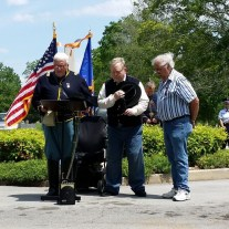 McReynolds and McTeer bow heads as Lane reads dedication prayer