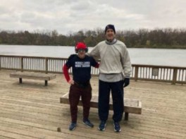 two friends standing by a lake after a 28 mile run