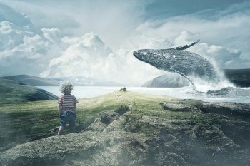 Epic photo of a child on a green coastal shore who is watching a whale jumping over a house