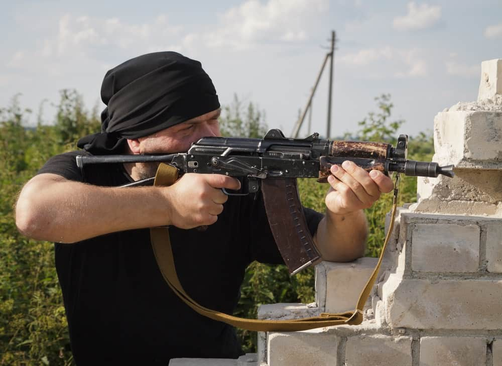 Photo showing a prepper shooting an AK-47 how many rounds of ammo does he need?