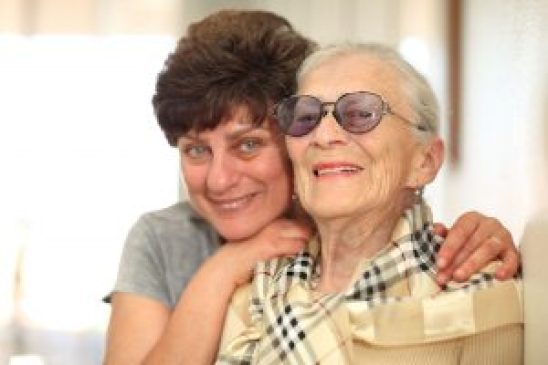 4710556 - happy woman with elderly mother, laughing together. shallow dof, focus on the senior woman.