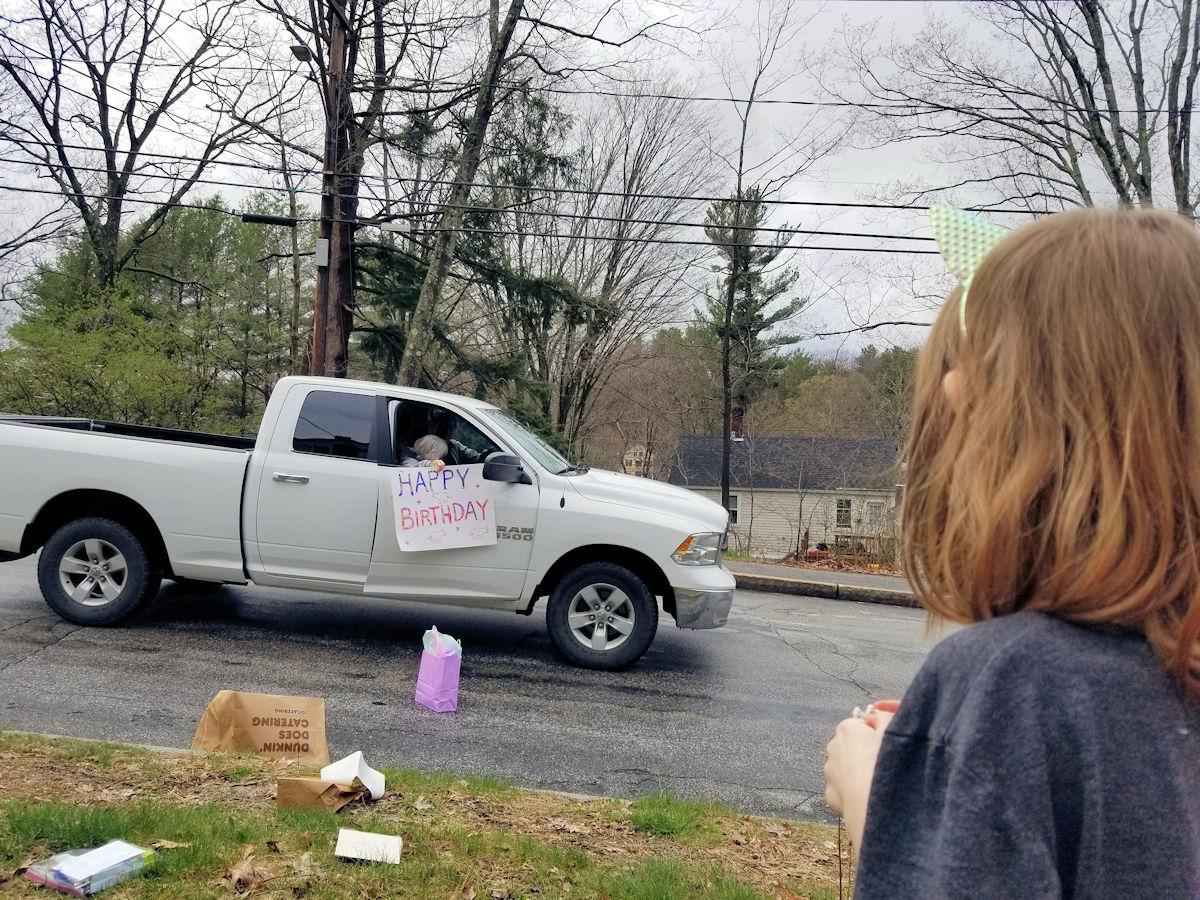A car drops off a gift