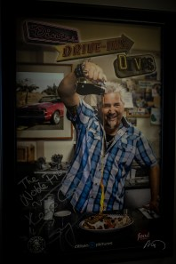 A signed gift poster from Guy Fieri of the Food Network.