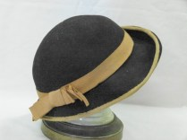 016/xxx - Black velour lady's winter hat with a medium brim that is narrower at the back.Brim is bound with caramel coloured grosgrain ribbon.Matching caramel grosgrain ribbon.