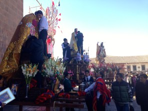 People preparing their floats- so many flowers and ornate decorations!