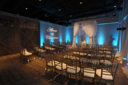 Wedding Ceremony Structure with Blue Uplights and Gobo