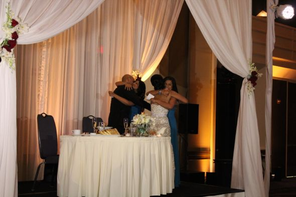 Gisha and Sanjay hugging guests