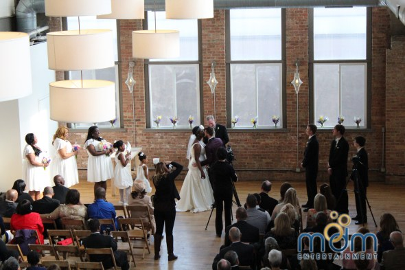 First Kiss at Kitchen Chicago and city view loft wedding ceremony