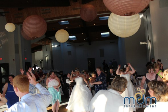 Brides dancing at White Pines wedding