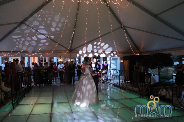 glowing pool stage at backyard wedding