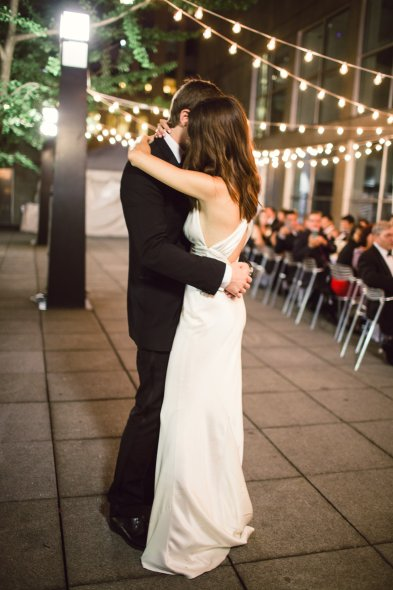 First dance at MCA wedding with string lights