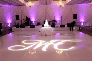Drape, Monogram, Uplighting and a White Vinyl Dance Floor for a Four Seasons Chicago Wedding