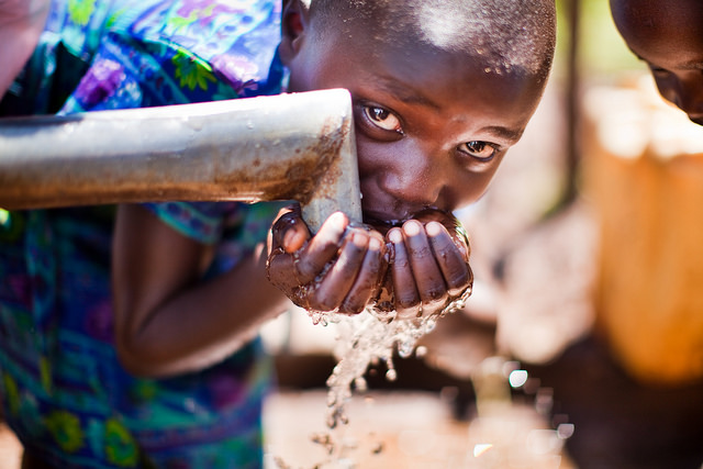 Child drinking from Lifewater well