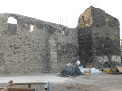 Reconstructing outer wall and tower adjacent to chapel