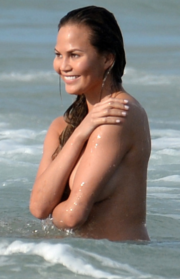 EXCLUSIVE TO INF. NO ONLINE UNTIL MARCH 12 2015 10AM EST March 10, 2015: Chrissy Teigen and her husband John Legend pose together for a Bruce Weber photo shoot in Miami Beach, Florida. After some PDA with John on the beach, Chrissy decides to lose her robe and frolic in the surf nude. Pictured here: Chrissy Teigen. Mandatory Credit: INFphoto.com Ref: infusmi-11/13