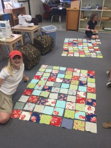 Students assembling their quilts during extracurricular sewing after school.
