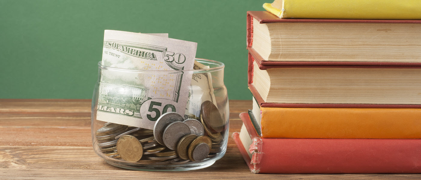 Money jar and stack of books